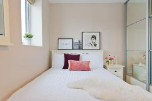 A bed or beds in a room at Broc House Suites