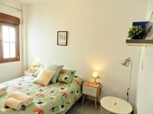 Un ou plusieurs lits dans un hébergement de l'établissement Homely Málaga Ancha del Carmen