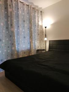 Posteľ alebo postele v izbe v ubytovaní Košice Smart Apartmán