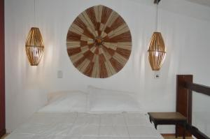A bed or beds in a room at Flat charmoso na praia