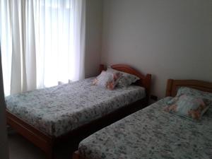 Cama o camas de una habitación en Casa Bahia Inglesa