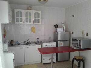 Una cocina o zona de cocina en Casa Bahia Inglesa