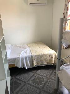 Cama o camas de una habitación en Residencial Costa do Sol