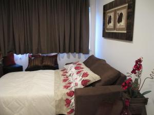 A bed or beds in a room at Apartamento Centro Solar da Colina