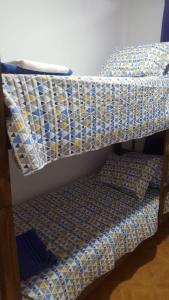 Una cama o camas cuchetas en una habitación  de Departamento JT Mendoza