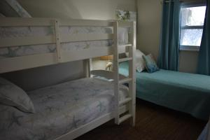 A bunk bed or bunk beds in a room at Salty Toes Cottage
