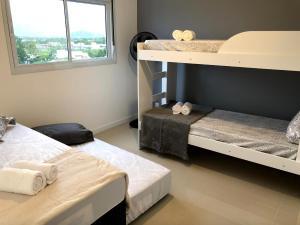 Litera o literas de una habitación en Apt Novo, Impecável, 1500m da Praia do Campeche