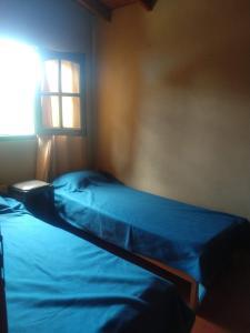 """Una cama o camas en una habitación de """"Zahra Depto"""""""
