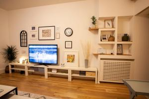 A television and/or entertainment center at BestStay Apartment No 9 Pedestrian zone