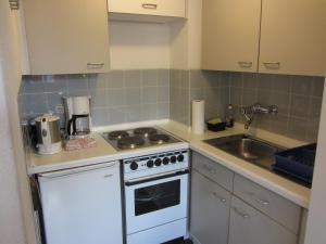 A kitchen or kitchenette at Apartment City West