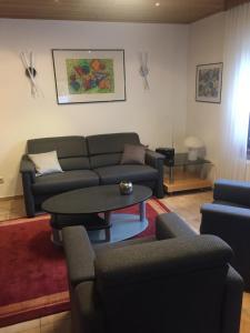 Ein Sitzbereich in der Unterkunft Ferienhaus am Ternscher See
