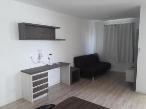 A television and/or entertainment center at Real Plaza Flat 1505