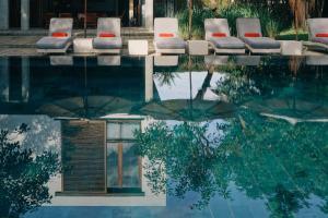 The swimming pool at or near Villa Ni Say
