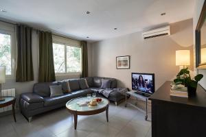 Ein Sitzbereich in der Unterkunft AinB Diagonal Francesc Macià Apartments