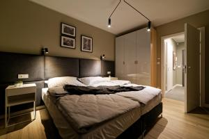 A bed or beds in a room at Martikal Apartment - PKP