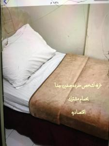 A bed or beds in a room at Yamamah