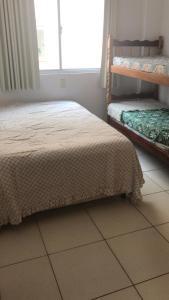 Cama o camas de una habitación en Residencial Melo