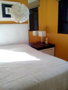 Cama o camas de una habitación en Cobertura em Resort