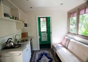 A kitchen or kitchenette at Onetangi Cabin