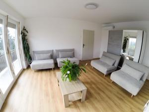 Гостиная зона в Apartments&Rooms Andrej
