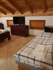 Posteľ alebo postele v izbe v ubytovaní Stodola apartment