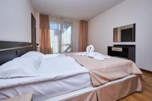 Ліжко або ліжка в номері Sunrise Park Complex