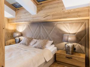 Łóżko lub łóżka w pokoju w obiekcie Mont Blanc Deluxe