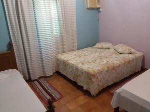 A bed or beds in a room at Casa de Temporada em Bonito