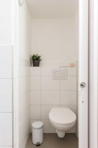 Ein Badezimmer in der Unterkunft Apartments At I.P.Pavlova