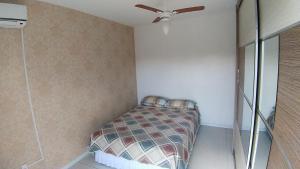 Cama o camas de una habitación en Apartamento em Canasvieiras