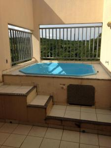 The swimming pool at or near Residencial Thermas Paradise