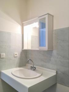 Salle de bains dans l'établissement City Résidence Avignon (5 Epi)