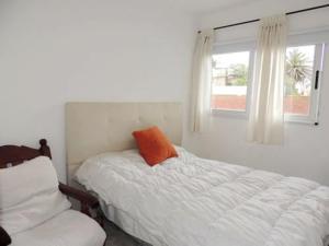 Una cama o camas en una habitación de cielomar 13
