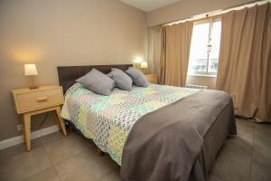 Una cama o camas en una habitación de Apartamento Mitre