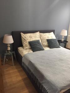 Posteľ alebo postele v izbe v ubytovaní Apartamenty Bulwary Książęce