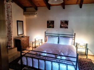 מיטה או מיטות בחדר ב-Casa di Maria
