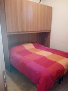 A bed or beds in a room at Ovindoli Via della Fonte 52A
