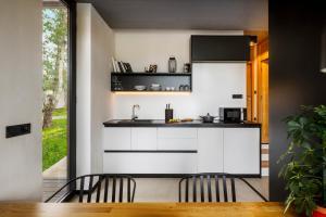 A kitchen or kitchenette at Marbera Flora Green Villas