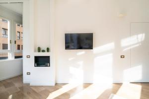 A television and/or entertainment center at NEW - Beautiful apartment in a perfect location