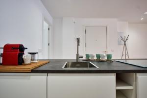 A kitchen or kitchenette at Virgen del Valle Deluxe Suite