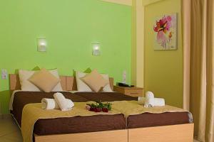 Ένα ή περισσότερα κρεβάτια σε δωμάτιο στο Anthena Studios
