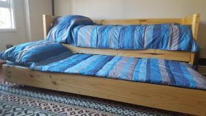Cama o camas de una habitación en Aparments R&G Puerto Montt