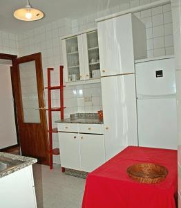 A kitchen or kitchenette at Piso con vistas, cómodo y con buena ubicación