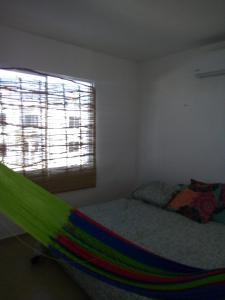 A bed or beds in a room at Calle 17B mar y Luna