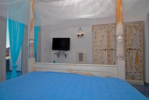 A bed or beds in a room at Ethereal Apartments