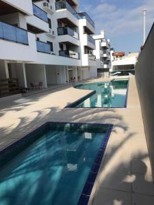 The swimming pool at or close to Excelente Apartamento nos Ingleses/Santinho