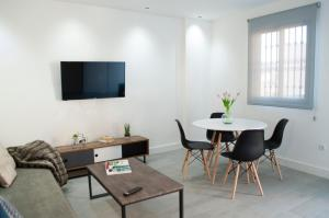 A television and/or entertainment center at MyFlats - DS Villavieja