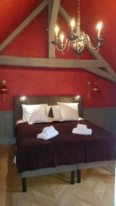 Ein Bett oder Betten in einem Zimmer der Unterkunft Parc Royal Appartements