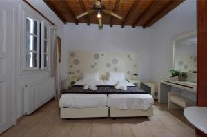Cama o camas de una habitación en Adonis Rooms