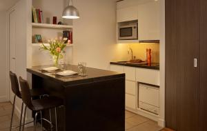A kitchen or kitchenette at Citadines Trafalgar Square